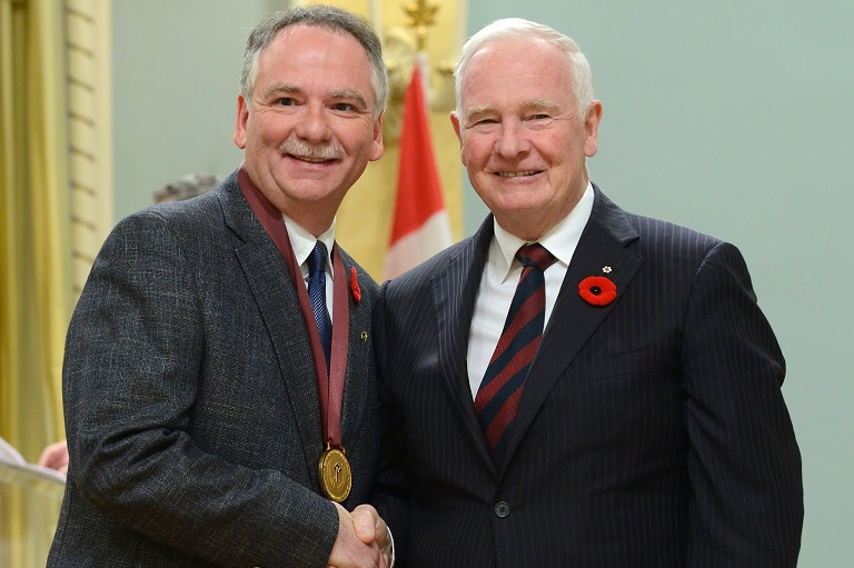 Gérald Charron accepting his award at Rideau Hall, 2014.
