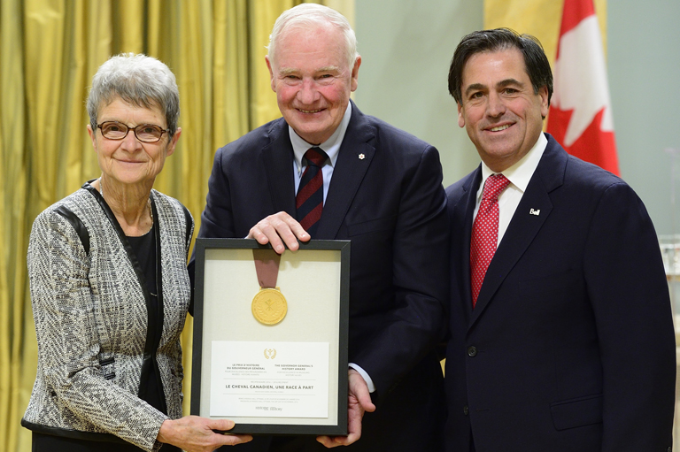 Madeleine Juneau and Pierre Rodrigues accepting their award on behalf of la Maison Saint-Gabriel at Rideau Hall in Ottawa.