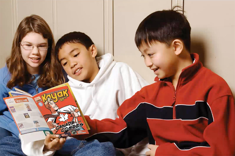 This image shows children reading an issue of Kayak: Canada's History Magazine for Kids