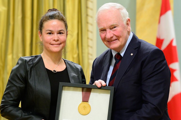 Director Julie Bellefeuille receiving the Governor General's History Award on behalf of the Centre d'archives at Rideau Hall in Ottawa, 2016.