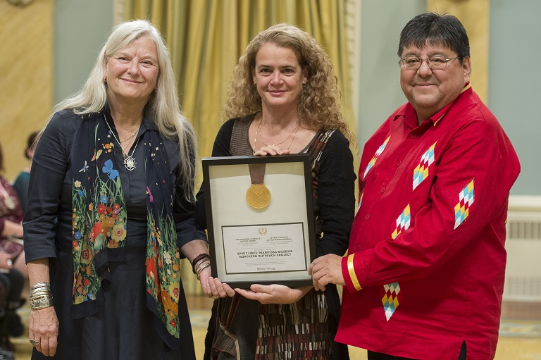 Julie Payette, Governor General of Canada, holds a framed certificate