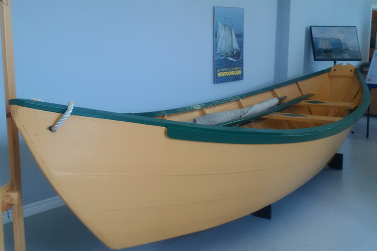 This image shows a wooden boat in a building.
