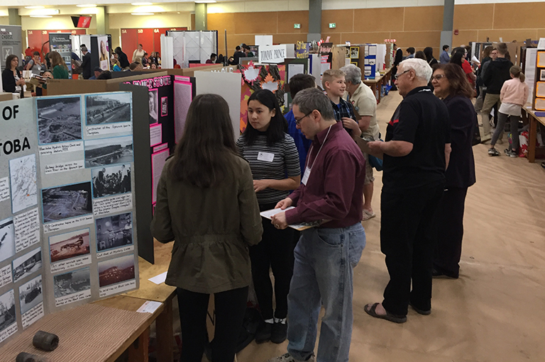 This image shows Judges speaking with students at the Red River Heritage Fair.