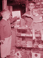 1950s era scene of two children putting change in a container.