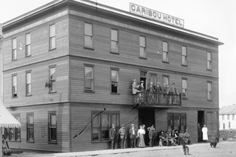 Photograph of a group of people outside the Caribou Hotel.