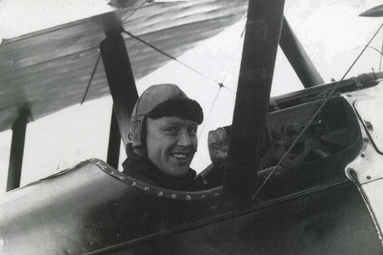 Black and white photo of Raymond Collishaw in the cockpit.