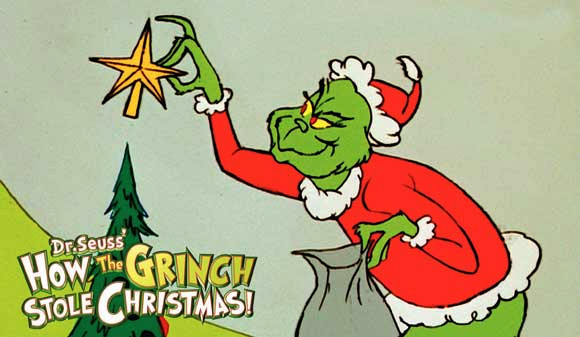 Still shows Grinch placing star on top of Christmas tree.