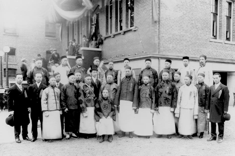 Group in front of Chinese School, Fisgard Street, Victoria, British Columbia.