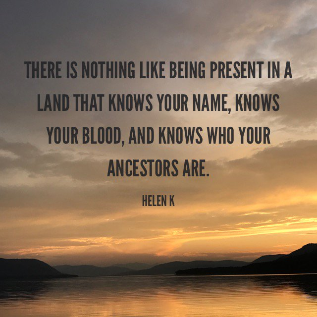 This image shows a orange glowing sky over water and reads: There is nothing like being present in a land that knows your name, knows your blood , and knows who your ancestors are. - Helen K