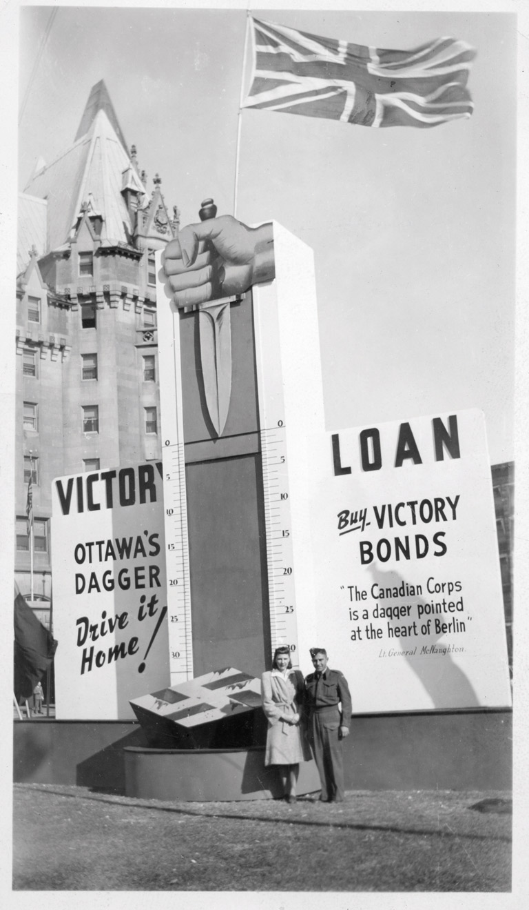 Photograph of Helen Scherempp Hochstein and Wilfred Schrempp in front of Ottawa's Dagger victory loan thermometer.