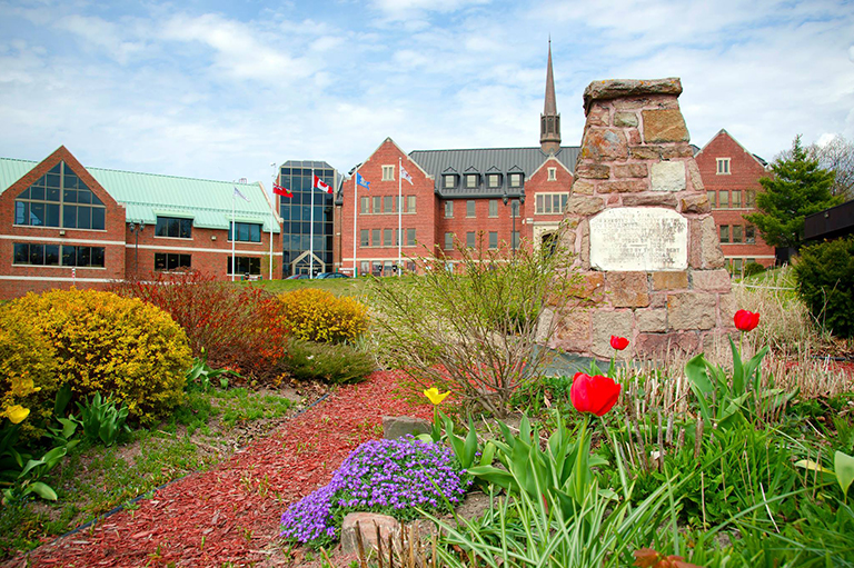 Front lawn and Shingwauk Hall building of Algoma University.