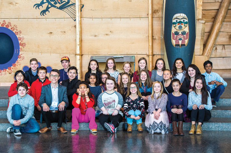 Colour photograph of students posing at the Canadian Museum of History. Photo: Brittany Gawley Photography