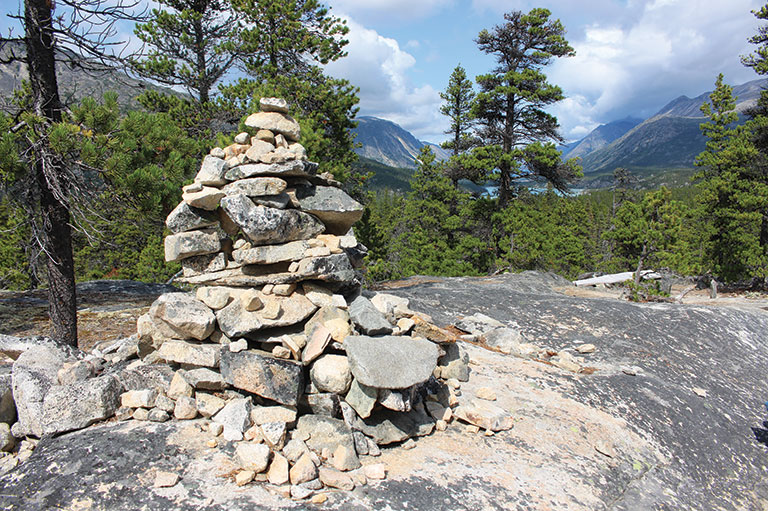 Colour photo of an inukshuk on the trail