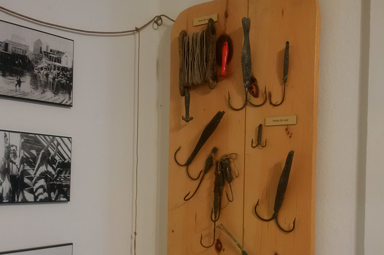 This image shows a variety of hooks on a wooden plaque hanging on a wall.