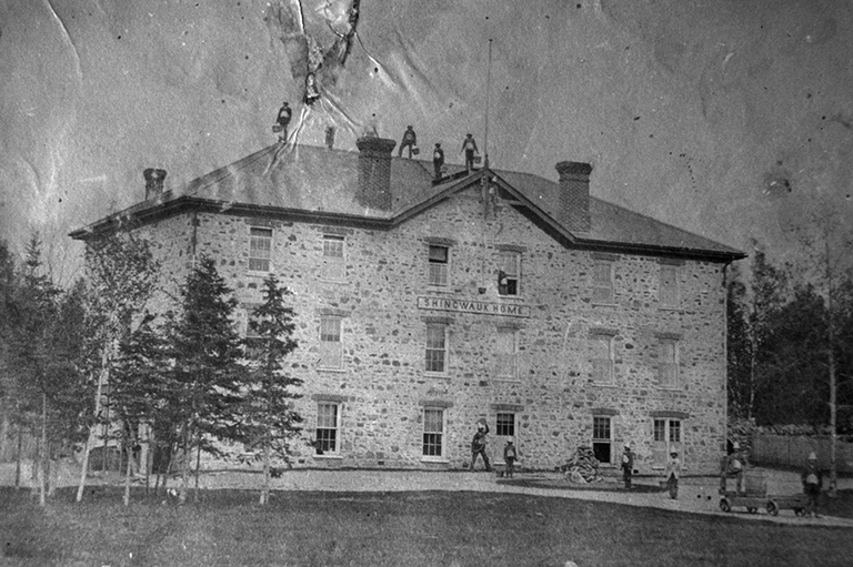 Photograph of boys during a fire drill at the Shingwauk Home, 1877.
