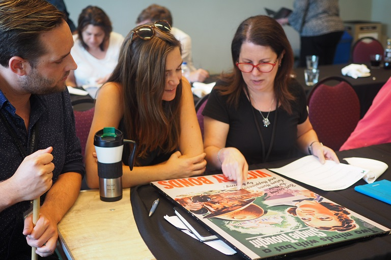Participants working with Second World War posters at the 2018 HTSI.