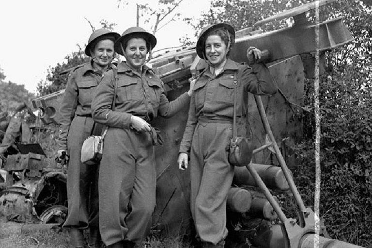 This image shows three smiling women in uniforms.