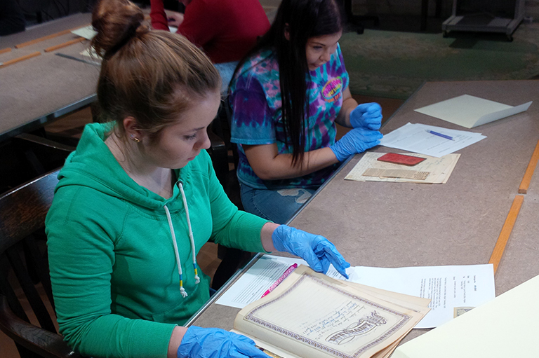 DHP students Hannah & Kathryn learn archival analysis and research methods using documents from the DCMA Archives, in preparation for The Canada Case.