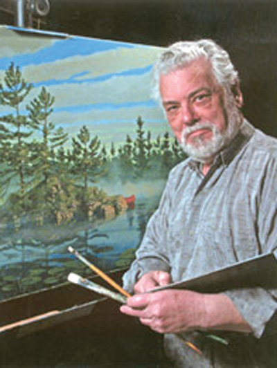 Man looking at camera with palette and paint brush in hand and a painted canvas behind him.