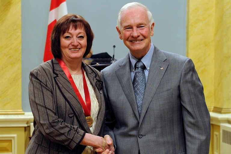 Lucie Labbé accepting her award at Rideau Hall, 2010.