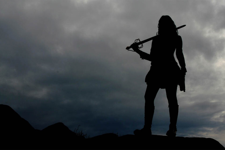 Silhouette of a swordswoman
